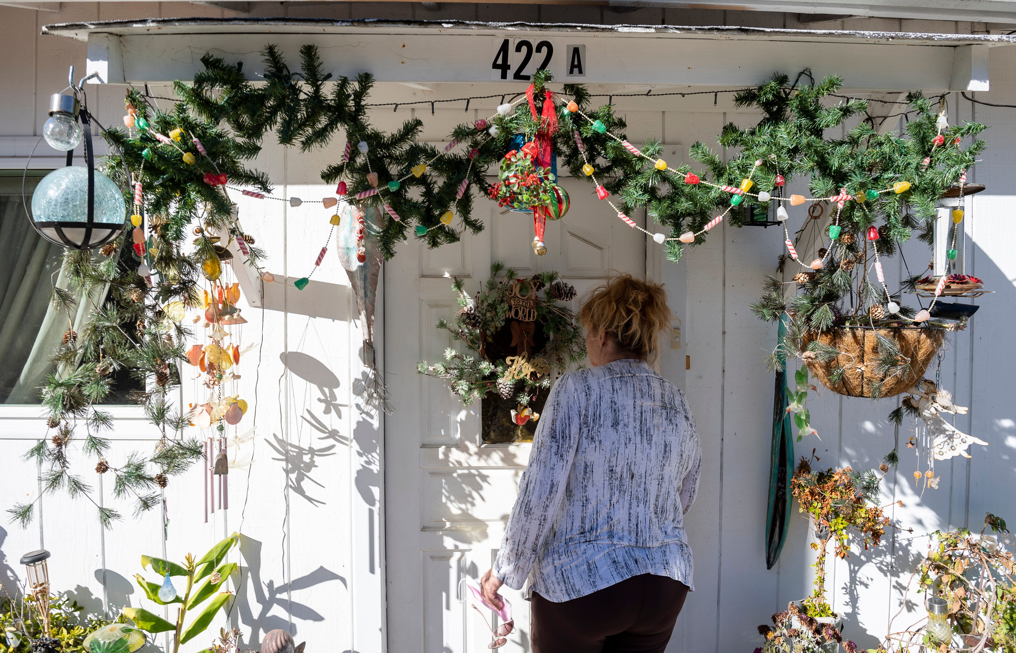 Susan Brzovich enters the home she rents in Prunedale, Calif., on Friday, Nov. 27, 2020.