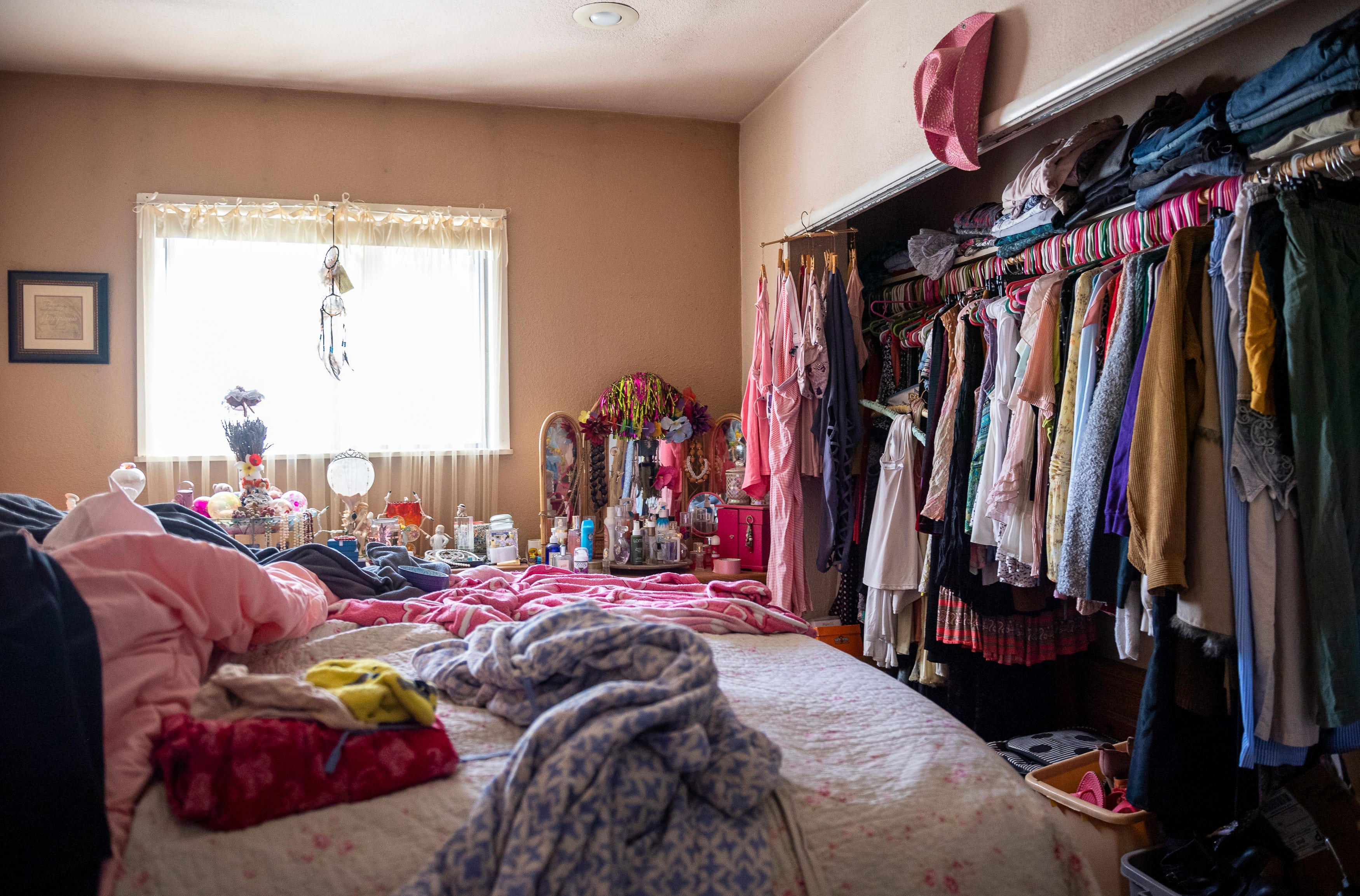 Susan Brzovich's room is filled with clothes, blankets, and other accessories in Prunedale, Calif., on Friday, Nov. 27, 2020.