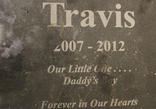 "Comanche County Sheriff's deputies discovered a gravestone with the name ""Travis"" on an abandoned property."