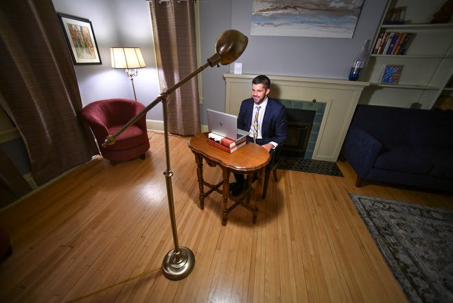 Rep. Dan Wolgamott prepares for people to join an emergency virtual town hall from his living room Monday, Nov. 30, 2020, in St. Cloud.