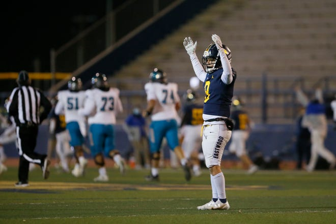 Eastwood's Curtis Murillo signals a touch down during the game against Pebble Hills in 1-6A football Monday, Nov. 30, at Eastwood High School in El Paso.
