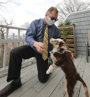 Dr. Mark Kittleson, chair of public health, New York Medical College, at his Ossining home with his dog, Toby Dec. 1, 2020.