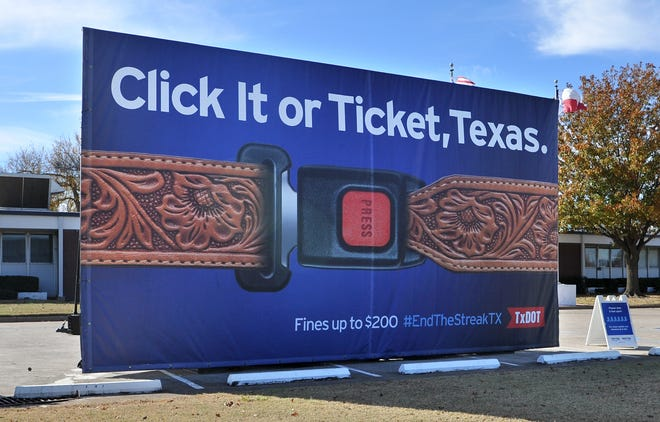 """The Texas Department of Transportation displayed their """"Texas-sized"""" billboard Tuesday morning as a reminder to Buckle Up Texas. The billboard was displayed in the TxDOT parking lot on Southwest Parkway."""