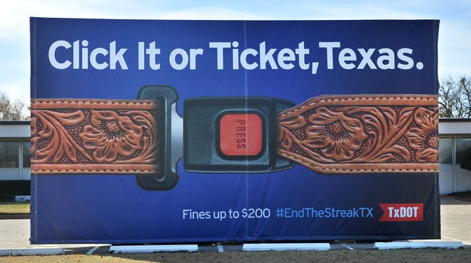 "The Texas Department of Transportation displayed their ""Texas-sized"" billboard Tuesday morning as a reminder to Buckle Up Texas. The billboard was displayed in the TxDOT parking lot on Southwest Parkway."