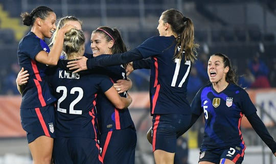 USWNT players celebrate a goal by Kristie Mewis (22) in  a friendly against The Netherlands on Nov. 27. The U.S. won the game, 2-0.