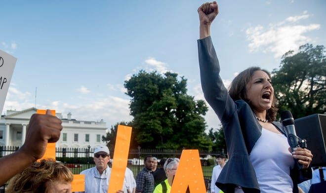 Center for American Progress President Neera Tanden speaks at a protest outside the White House, Tuesday, July 17, 2018, in Washington.