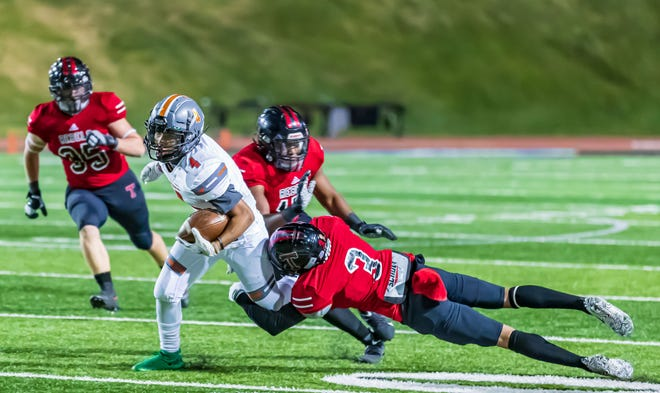 A Tascosa defender makes a tackle during the Rebels 32-13 win against Caprock Nov. 12. The Rebels will face Lubbock Coronado for the district championship at 7 p.m. Thursday at Dick Bivins Stadium.