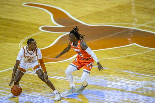 Texas Longhorns guard Matt Coleman III (2) drives down the court against University of Texas Rio Grande Valley (14) Javon Levi of a NCAA basketball game at the Frank Erwin Center, Wednesday November 25, 2020. [RICARDO B. BRAZZIELL/AMERICAN-STATESMAN]