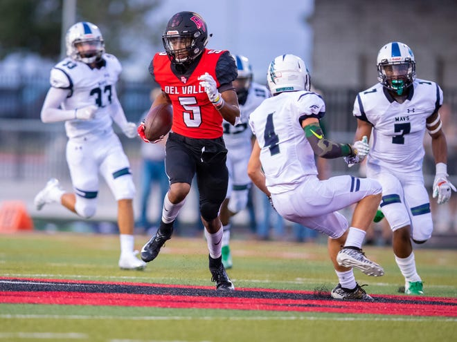 Del Valle, TX; Del Valle Cardinals wide receiver Caleb Burton (5) runs after a pass reception against the McNeil Mavericks during the first quarter at the non-district football game on Friday, Aug 30, 2019, at Del Valle High School. [JOHN GUTIERREZ/FOR STATESMAN]