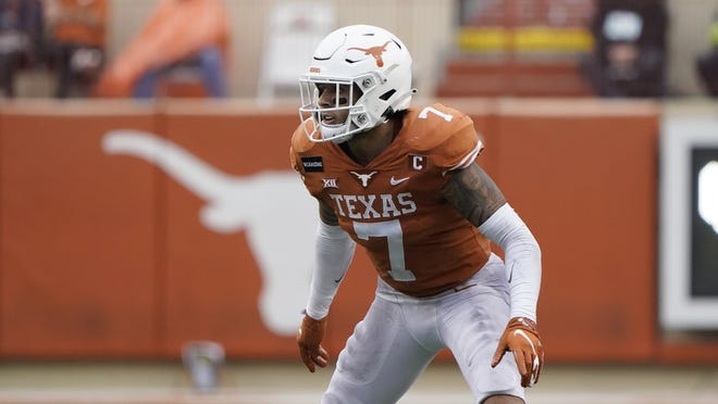 ]Texas defensive back Caden Sterns (7) during the second half of an NCAA college football game against Iowa State, Friday, Nov. 27, 2020, in Austin, Texas. (AP Photo/Eric Gay)
