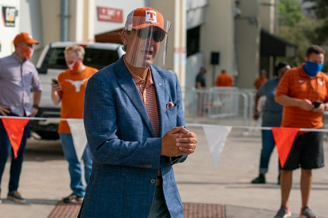 Texas athletic director Chris Del Conte watches as the football team enters Darrell K. Royal Memorial Stadium before an NCAA football game between Texas and UTEP, Saturday, Sept., 12, 2020. [Stephen Spillman for Statesman]