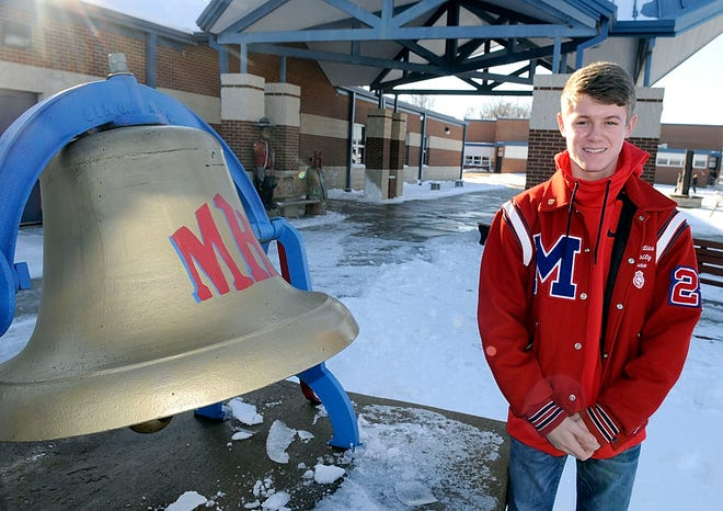 Mapleton High School junior Evan Dennison poses outside of the school on Dec. 2. The teen overcame Stevens-Johnson syndrome this year, a rare and life-threatening reaction to a medication, in this case one his doctor had prescribed for treatment of acne.