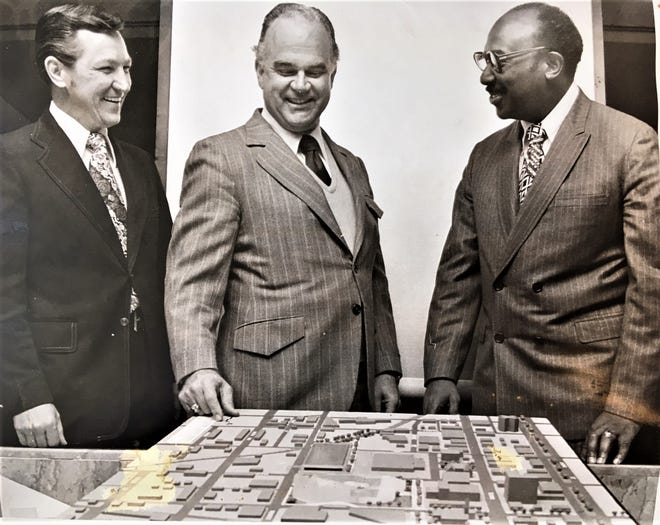 Don Neal (from left), Gene Holley and Ed McIntyre  look over plans for new civic center in the 1970s