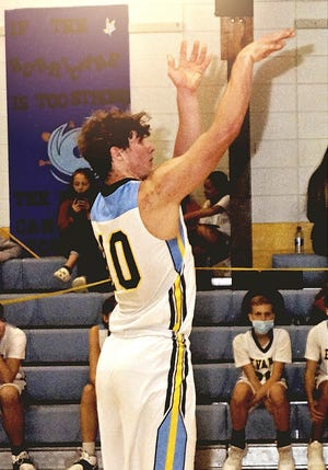 Wyatt Austin (10) poured in 26 points to lead Evans to its fifth straight win on Monday.
