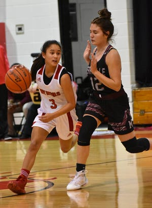 Merryville's Kailee Hickman (12) attempts to cut off Pickering's Ariana Yates during the Lady Panthers' 83-9 win over the Lady Red Devils on Monday.