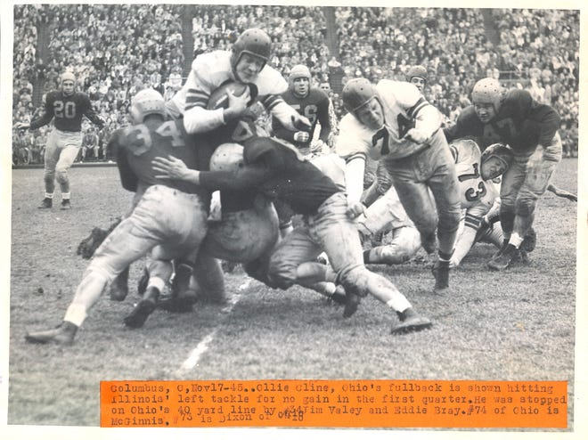 Fullback Ollie Cline, here trying to find yardage in a Nov. 17, 1945, game against Illinois, was named the Big Ten's most valuable player that season by rushing for a league-high 936 yards.