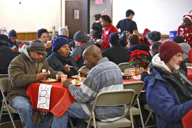 People enjoy the annual Bethlehem on Broad Christmas meal at First Congregational Church, 444 E. Broad Street, last Christmas. The tradition of feeding, entertaining and caring for the less fortunate served by area ministries dates back more than three decades.