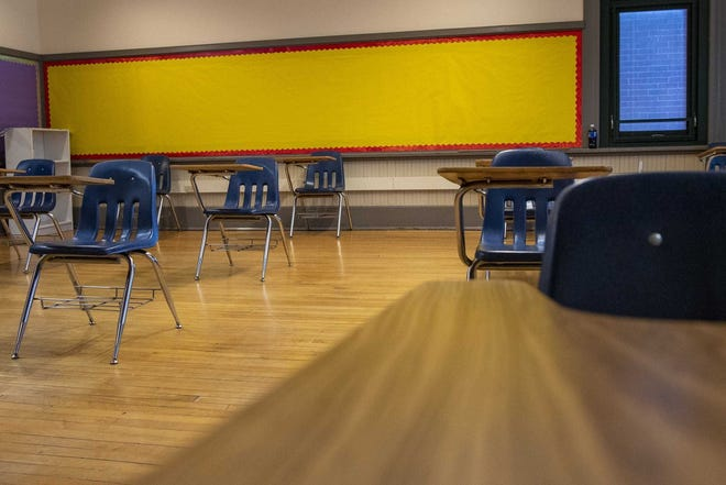 A classroom sits empty at Southwood Elementary School on the South Side as students learn remotely.  Ohio students currently must take state standardized tests in person, even if learning remotely, but many aren't doing that.
