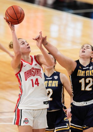 Ohio State forward Dorka Juhasz shoots against Kent State's Annie Pavlansky, center, and Linsey Marchese during the second quarter in the Covelli Center. Juhasz finished with 16 points and 10 rebounds.