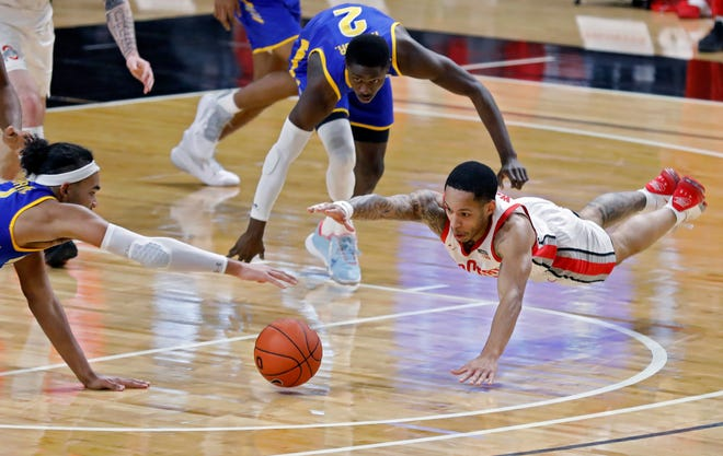 Ohio State Buckeyes guard CJ Walker (13) dives for the ball against Morehead State Eagles forward Johni Broome (4) during the first half of their game at Covelli Center in Columbus, Ohio on December 2, 2020.