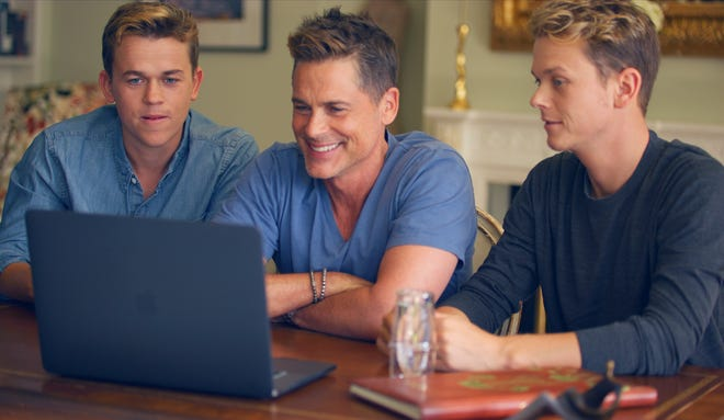 Rob Lowe sits with his two sons Matthew, left, and John while on a video call with John Scott, a Delaware resident. Lowe and Scott share a common ancestor and are third cousins.