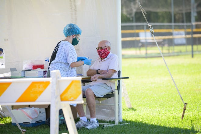A man gets tested for the COVID-19 antibody earlier this year at Venetian Gardens in Leesburg. [Cindy Peterson/Correspondent]