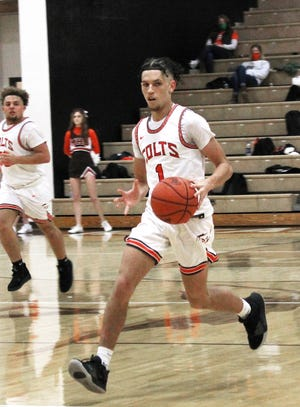 Meadowbrook's Jerome Todd (1) dribbles the ball up court with senior teammate Tyler Lacey (33) trailing the play during Tuesday''s 83-49 season opening win over Philo in Muskingum Valley League play at Meadowbrook High School. Todd finished with 16 points for the Colts in the home court victory.
