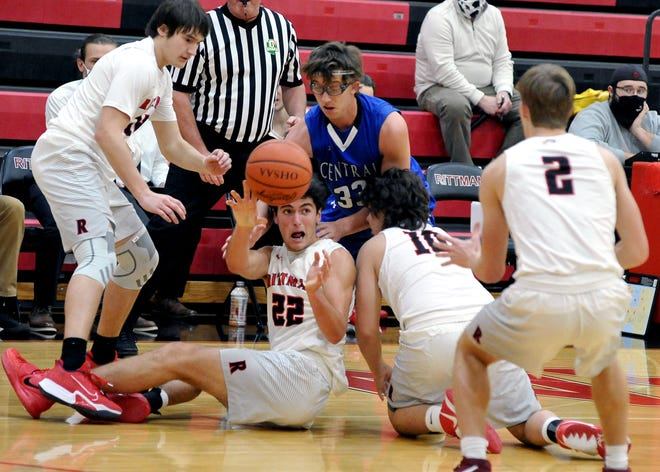 Rittman's Nick Swartz gets a loose ball to a teammate. Swartz led all scorers in Rittman's win over Central with 21.