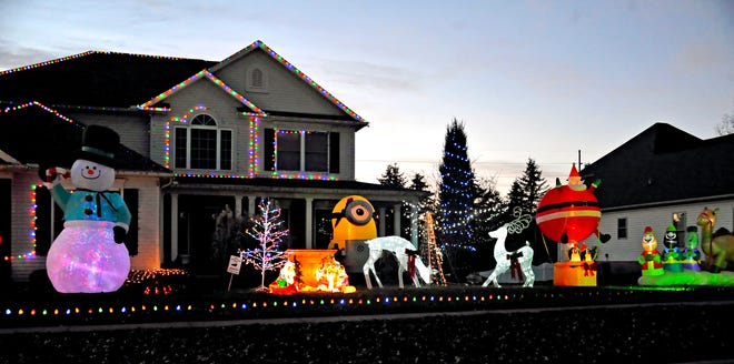 If you have Christmas lights and decorations outside of your home and live in the 44691 zip code, you can register to be a part of the Wooster Area Chamber of Commerce Let It Glow event. This photo shows a decorated house for December 2019.