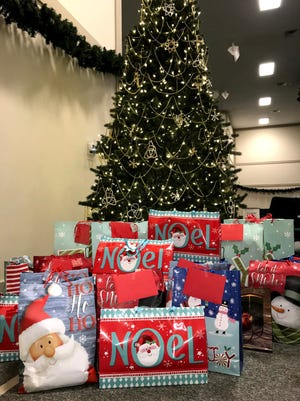 Wrapped gifts from the 2019 Davidson County Foster Elves project are pictured under a tree waiting on Santa to pick up and deliver to county children in foster care.