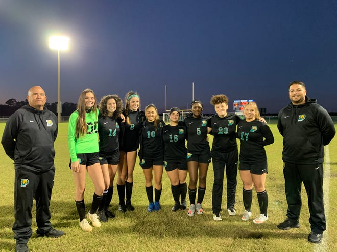 Pine Ridge's girls soccer team celebrated Senior Night with a 9-2 victory over Mainland. From left is Assistant Coach Jay Lecureux, Makayla Still, Dana Sawyer, Justine St. Louis, Aracely Cortez, Alexys Hatley, Asia Olude, Kira Deleon, Ashlynn Wise and Head Coach Benjamin Noboa.