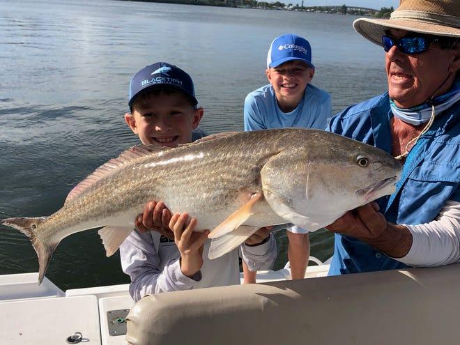 Landon Davis caught this redfish on his 10-year-old birthday.