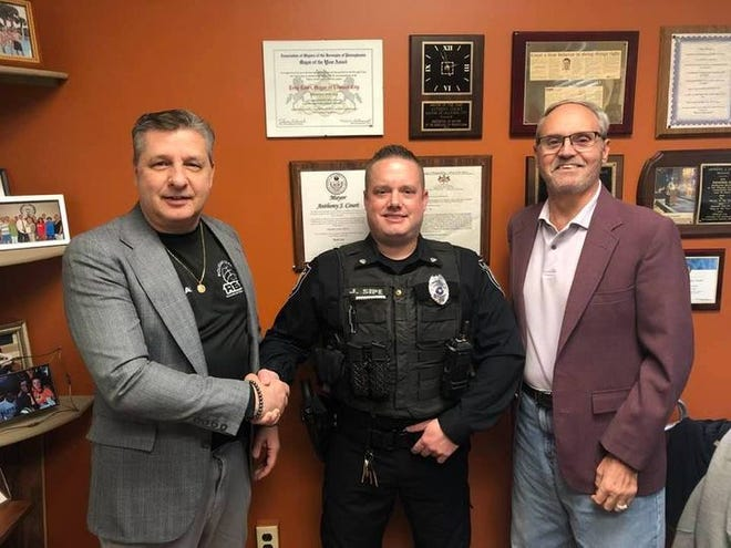 Ellwood City has welcomed a new full-time officer. Joshua Sipe (center) was sworn in Nov. 30 by Mayor Anthony Court (left) with council President George Celli (right). The borough's police department now has 10 full-time and three part-time officers.