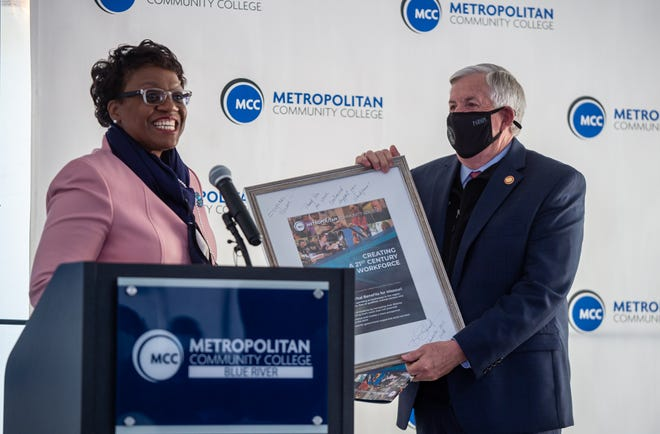 Missouri Gov. Mike Parson receives a token of appreciation from Metropolitan Community College Chancellor Kimberly Beatty after he spoke at the ground breaking for the new MCC-Blue River East Campus in Independence Wednesday afternoon.