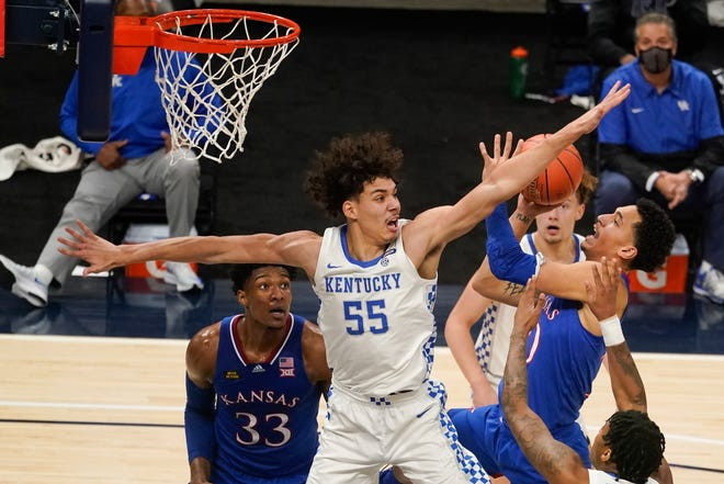 Kansas' Jalen Wilson (10) shoots as Kentucky's Lance Ware (55) defends during the first half of Tuesday's game in Indianapolis. Wilson scored 21 of his career-high 23 points in the second half to lead the Jayhawks to a 65-62 victory.