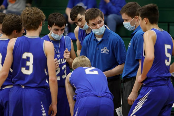 Danville co-head-coaches twin brothers Michael Soukup, center and Steven, talk with players during their game against West Burlington, Tuesday Dec. 1, 2020 at West Burlington High School.