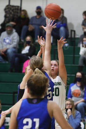 West Burlington High School's Abbey Bence (20) puts up a shot during their game against Danville High School, Tuesday Dec. 1, 2020 at West Burlington.
