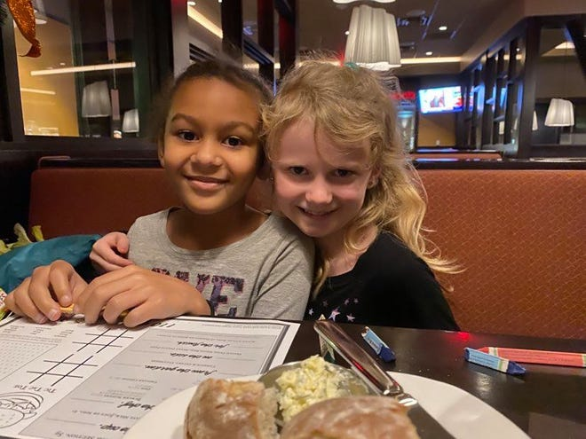 After Annalisse Hocking (right) wrote a letter to Santa asking for help finding her friend who moved away, Nyla Loftis (left), hundreds of community members used Facebook to help Santa fulfill the wish and reunite the girls at the 110 Grill in Rochester Monday night.