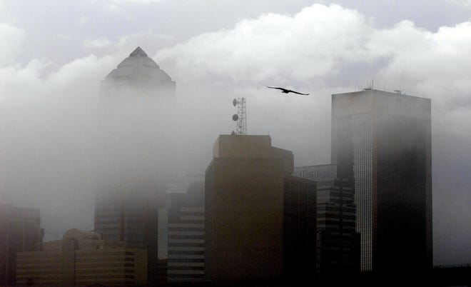 RICK WILSON/The Times-Union--1/21/10-- Fog caused by cooling temperatures following severe weather shrouds the buildings of the downtown Jacksonville, Fl. skyline Thursday afternoon January 21, 2010. (The Florida Times-Union, Rick Wilson)