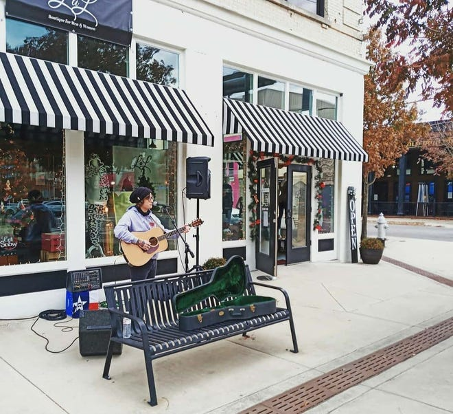 Nylan Garrett performs outside LAL Boutique in downtown Sherman as a part of Small Business Saturday.