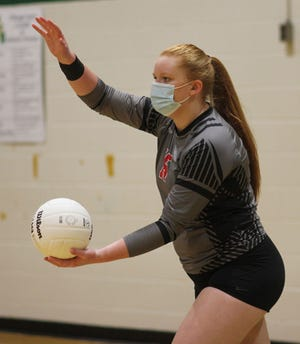 Jacksonville's Julianna Erickson prepares to deliver a serve during the Cardinals' 25-10, 25-16, 25-21 win at White Oak on Tuesday night. [Chris Miller / The Daily News]