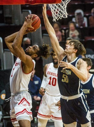 Bradley Brave Ari Boya rises under the basket with pressure from Judson University's Thomas Donati (50) Tuesday, December 1, 2020 at Carver Arena.