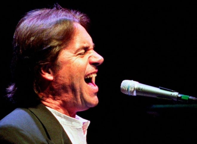 Dan Fogelberg plays before a packed house at the Peoria Civic Center Theater in 2003.