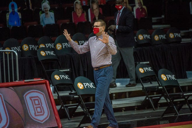 Bradley University head basketball coach Brian Wardle greets opposing coach Judson University's Bruce Fields from a distance before the start of their game at Carver Arena Tuesday, December 1, 2020.