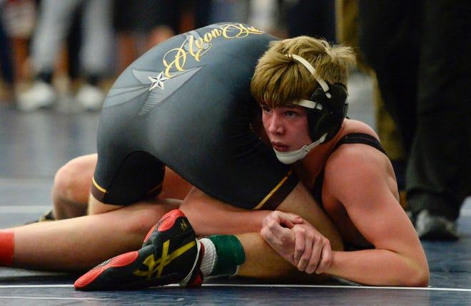 Stow-Munroe Falls' JR Reed wrestles Avon Lake's Ethan Sheppard during a match last season.