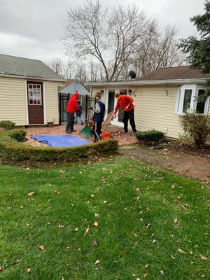 Two Cub Scout packs and two Boy Scout troops in Twinsburg helped rake leaves and haul them to the curb during this year's Yard Charge Nov. 21.