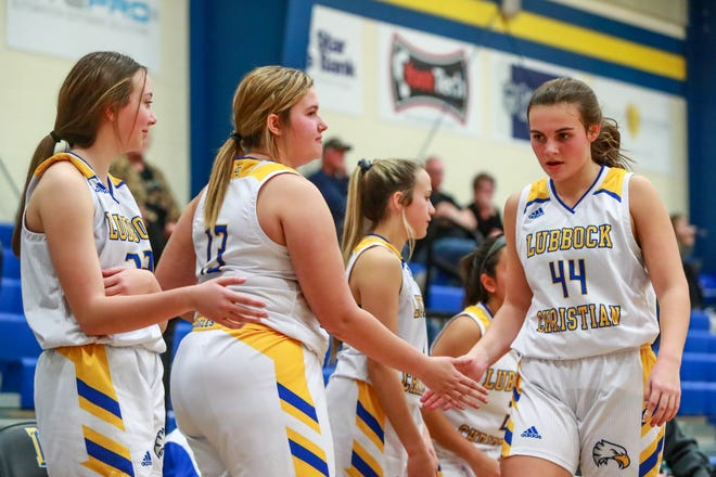 Lubbock Christian's Callie Roberts (44) is greeted after checking out of the game against White Deer on Tuesday, Dec. 1, 2020, at Eagle Athletic Center in Lubbock, Texas.