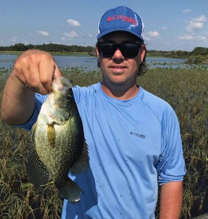 Bryan Horvat of Waco, Kentucky, caught this speckled perch while jigging the grass at Lake Kissimmee with Greg Watts of Frostproof recently.