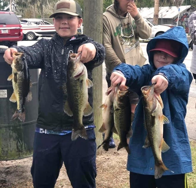 Rylee Fountain, 12, left, and Wyatt Keene, 10, had 8.80 pounds to win the Middle School division of the Lakeland Junior Hawg Hunters tournament on Nov. 21 on the Kissimmee Chain.