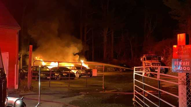 A fire at a Boxborough auto shop destroyed five vehicles.